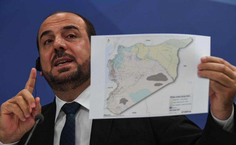 Nasr al-Hariri, the Syrian opposition's chief negotiator, gives a press conference in Moscow on October 26, 2018.