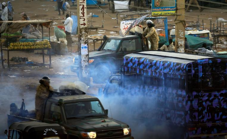 A tear gas canister is fired to disperse Sudanese demonstrators during anti-government protests in the outskirts of Khartoum, Sudan January 15, 2019..
