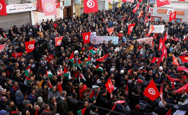 People gather during a nationwide strike against the government's refusal to raise wages in Tunis, Tunisia January 17, 2019.