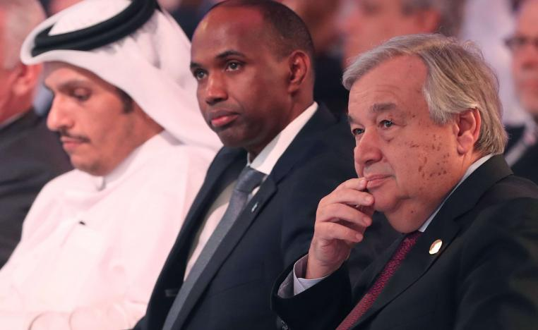United Nations' Secretary General Antonio Guterres (R) and Somalia's Prime Minister Hassan Ali Khaire (C) attend the Doha Forum