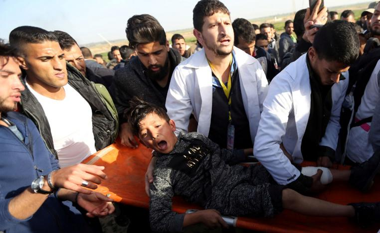 A wounded Palestinian boy reacts as he is evacuated during a protest at the Israel-Gaza fence, in the southern Gaza Strip January 25, 2019.