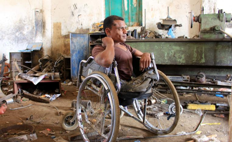 Yaarub Eissa sits in his wheelchair at a blacksmith workshop where he works in Abs, in the northern province of Hajjah, Yemen January 19, 2019.