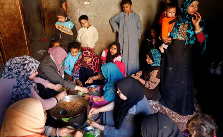An Egyptian family prepares a cabbage meal for lunch in the province of Fayoum, southwest of Cairo, Egypt February 19, 2019.