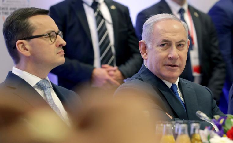 Feb. 14, 2019 photo shows Poland's Prime Minister Mateusz Morawiecki, left, and Israeli Prime Minister Benjamin Netanyahu, right, attend a meeting in Warsaw, Poland.