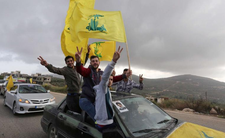 Supporters of Lebanon's Hezbollah leader Sayyed Hassan Nasrallah gesture as they hold Hezbollah flags in Marjayoun, Lebanon May 7, 2018.
