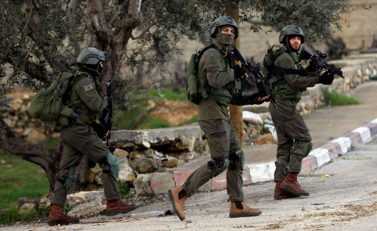 Israeli forces walk during a raid in Ramallah in the Israeli-occupied West Bank December 13, 2018.