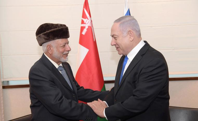 Israeli Prime Minister Benjamin Netanyahu (R) shakes hands with Minister of Foreign Affairs of Oman Yusuf bin Alawi during their meeting on the sidelines of the Warsaw Middle East Summit.