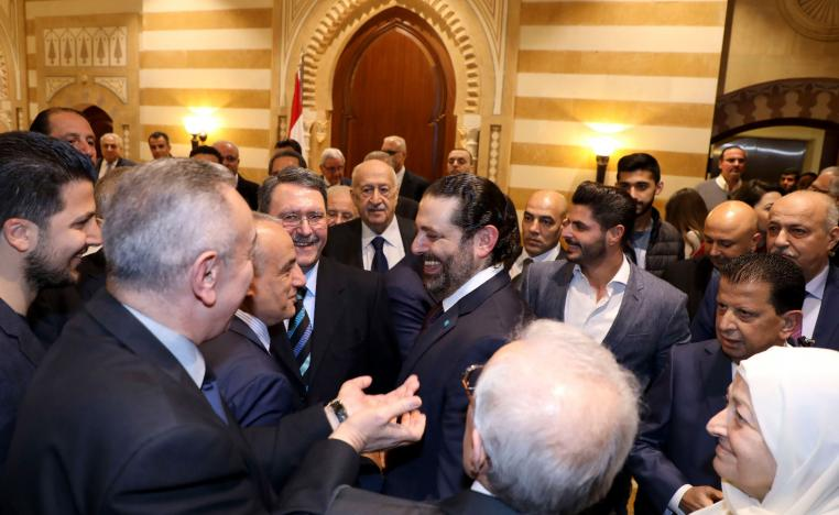 Lebanese Prime Minister Saad Hariri (C) stands amongst supporters after a press conference during which he announced the formation of a new national unity government following months of wrangling between rival groups, at Baabda Palace.