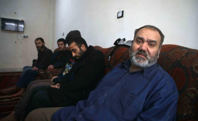 Syrian men suffering from mental issues sit together at al-Waalan special needs centre in northern town of Aldana near Syria's second largest city of Aleppo on February 14, 2019.