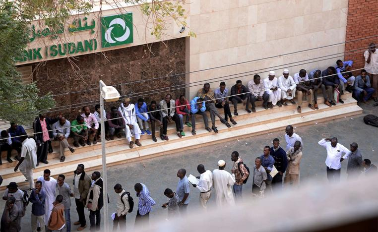 Many residents have to line up for hours to withdraw money