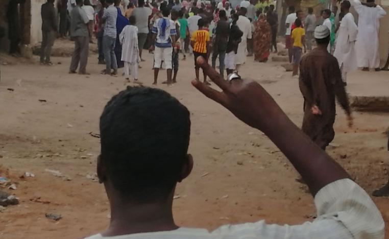 A Sudanese protester raises the victory sign during an anti-government demonstration in Khartoum on February 15, 2019.