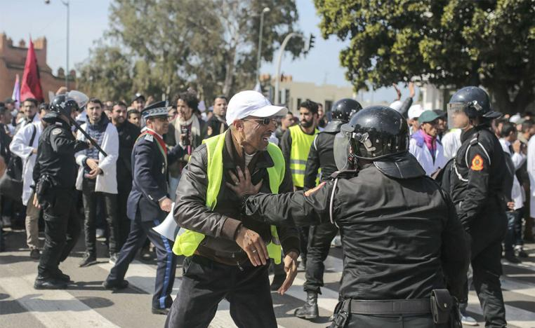 Police halting some of the teachers who decided to march on Rabat's royal palace