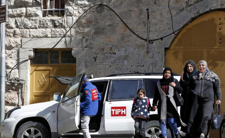 Palestinian Territories, Hebron: A Member of the Temporary International Presence in Hebron, (TIPH), gets in one of the organization's vehicles during a tour by the organization in the West Bank on 31 January 2019.