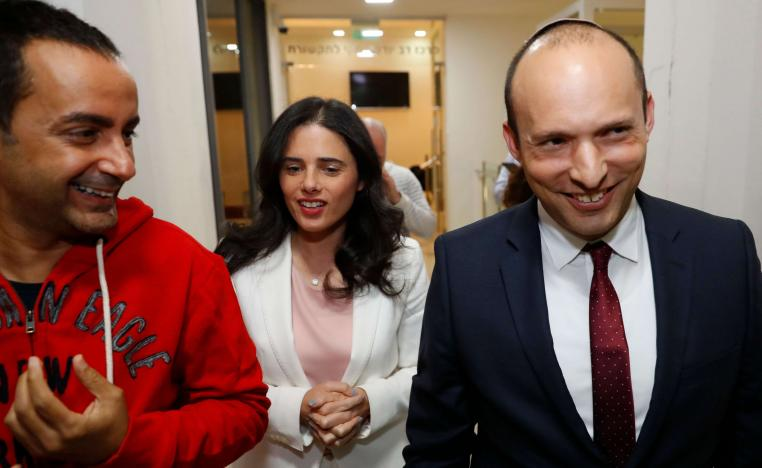 Israel's Minister of Education Naftali Bennett (R) and Israeli Justice Minister Ayelet Shaked (C) walk during a press conference to announce the formation of new political party HaYemin HeHadash or The New Right on December 29, 2018 in the coastal city of Tel Aviv.