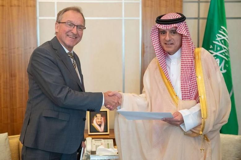 Saudi Foreign Minister Adel Al-Jubeir (R) shakes hands with German Ambassador to Saudi Arabia Joerg Ranau during their meeting in Riyadh