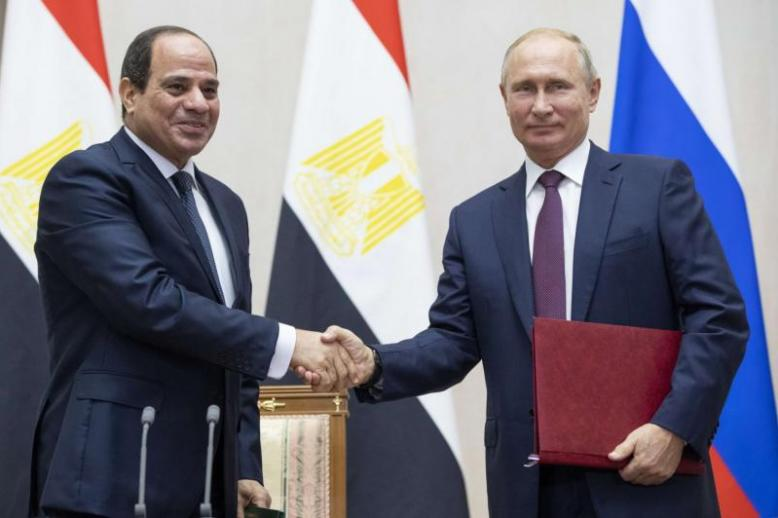 Russian President Vladimir Putin, right, and Egyptian President Abdel-Fattah el-Sisi shake hands after a signing ceremony following their talks in Sochi, Russia, Wednesday, October 17, 2018