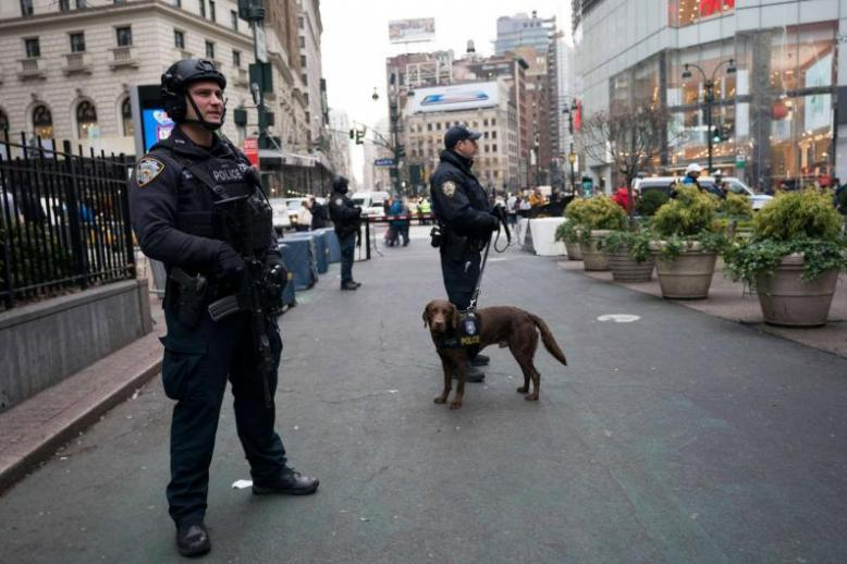 Police officers patrol the area around Herald Square in New York