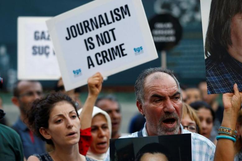 A 2016 file picture shows demonstrators shouting slogans during a protest against the arrest of prominent journalists in central Istanbul