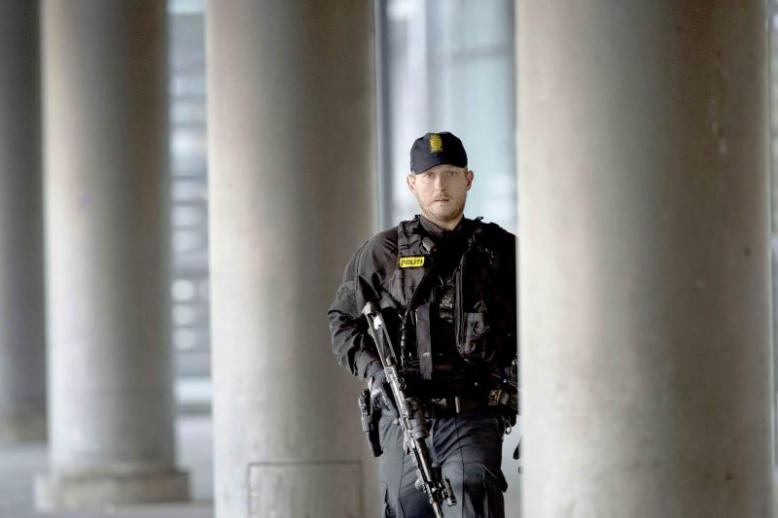 A Danish policeman stands guard outside a building in Copenhagen