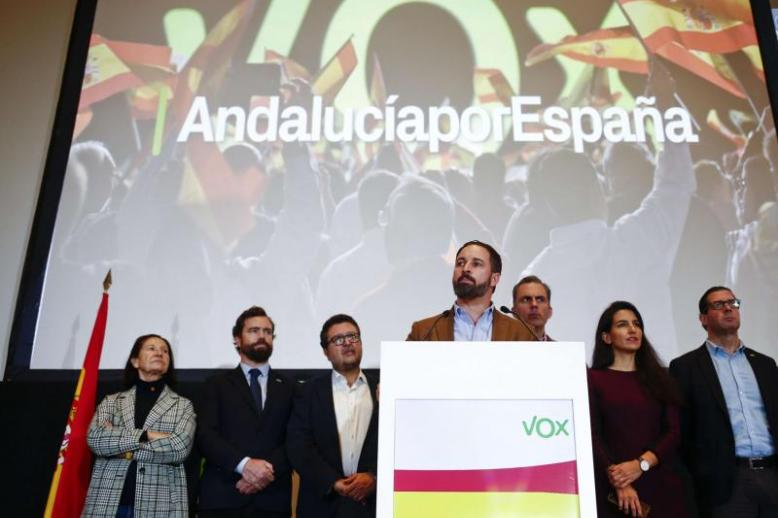 Spain's far-right Vox party leader Santiago Abascal (C-R) speaks during a news conference in Seville, December 3