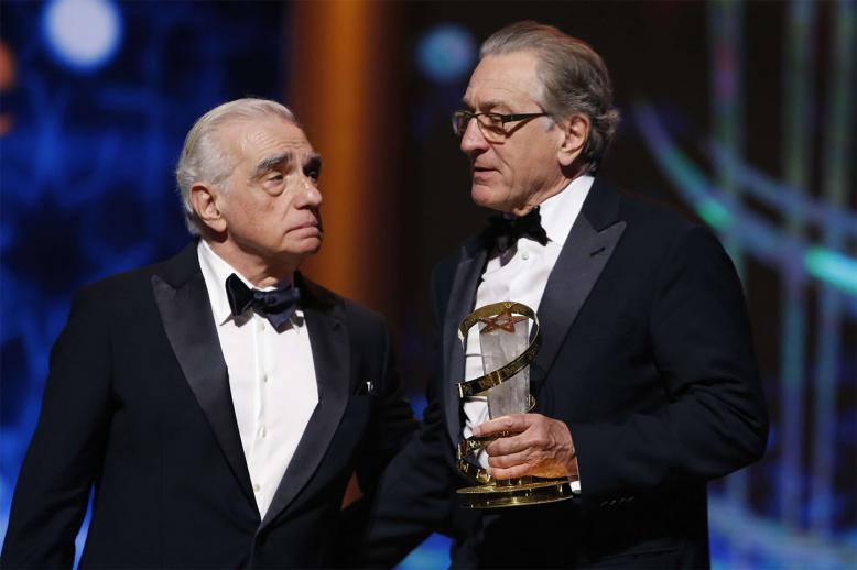 Robert De Niro (R) receiving a tribute award from US director Martin Scorsese to his contribution to acting