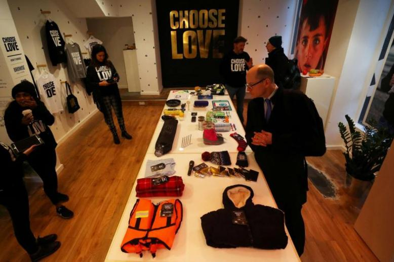 Customers looks at items for sale at the pop-up shop in London