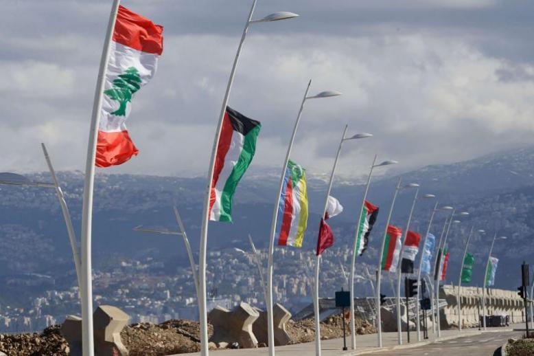 Overwhelmingly ceremonial. Flags of the Arab League members on display ahead of the Arab Economic and Social Development Summit in Beirut, January 17.