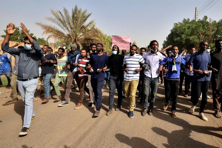 Sudanese demonstrators chant slogans as they participate in anti-government protests in Khartoum