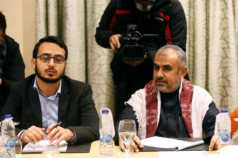 Hadi Haig (R), the head of the Yemeni Government delegation, attends a meeting to discuss prisoner swap deal