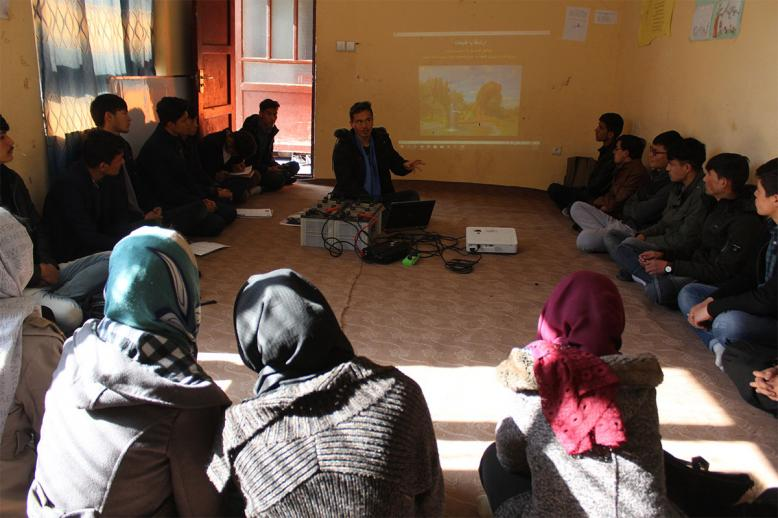"Muhammad Ali teaching a ""relational learning circle"" class during orientation at the APV Borderfree Center"