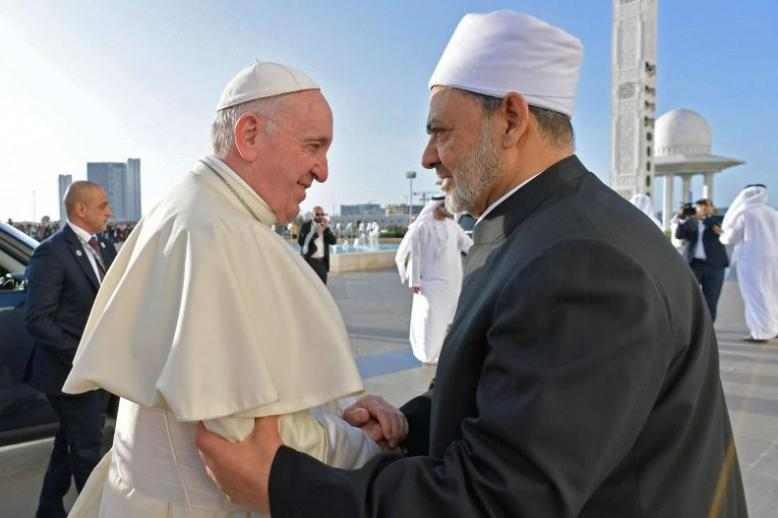 Pope Francis (L) greets Egypt's al-Azhar Grand Imam Sheikh Ahmed el-Tayeb as they arrive at Sheikh Zayed Grand Mosque in Abu Dhabi, February 4.