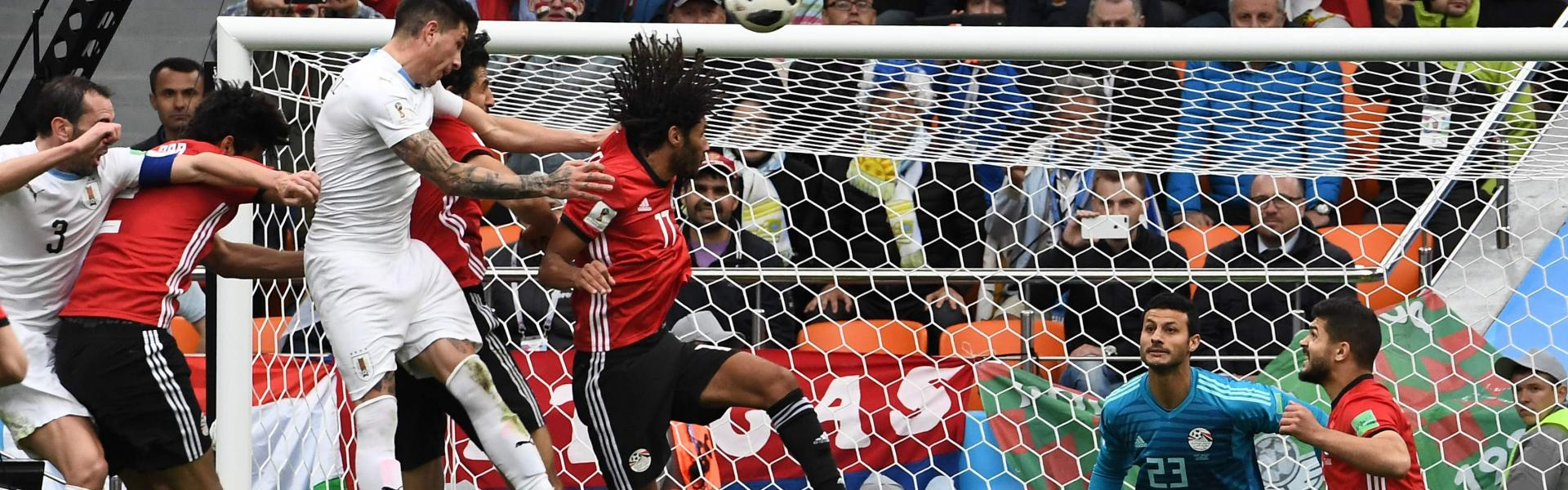 Uruguay's defender Jose Gimenez (3L) heads the ball to score the opening goal during the Russia 2018 World Cup Group A football match between Egypt and Uruguay at the Ekaterinburg Arena in Ekaterinburg on June 15, 2018.