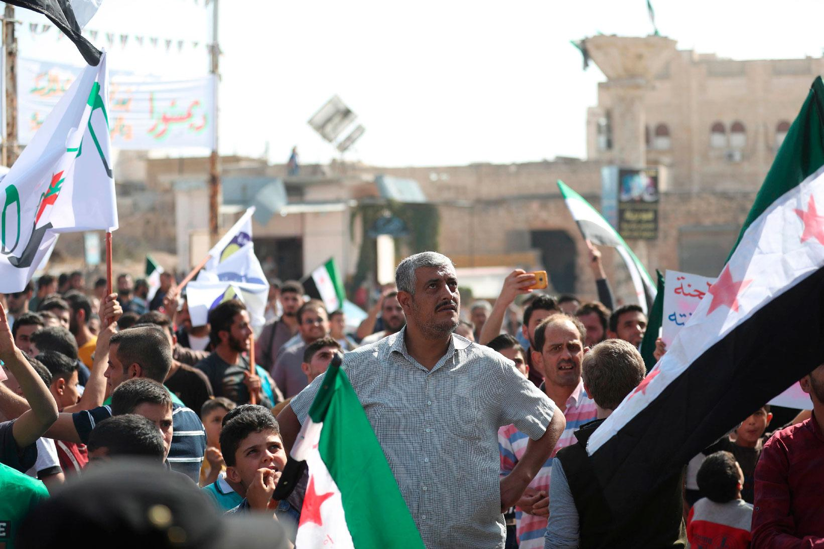 Bahr Nahhas (C) attends a demonstration in the rebel-held town of Maaret al-Numan, in the north of Idlib province on October 19, 2018.