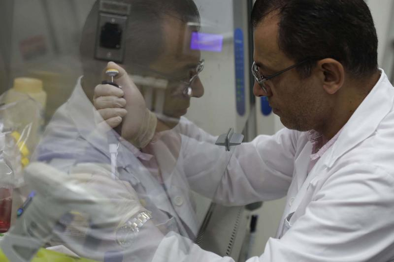 A professor in pharmaceutical sciences performs an in vitro test at a laboratory in the Lebanese American University (LAU) branch near Byblos.