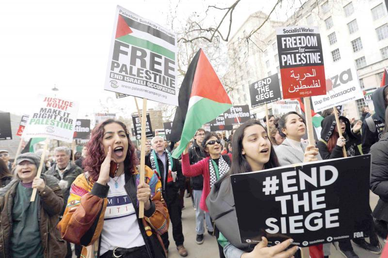 Protesters in central London shout slogans and hold placards during a demonstration in support of Palestinians, last April 7