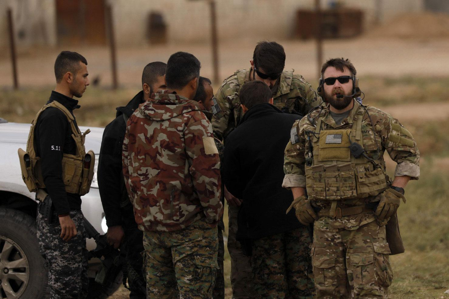 US forces and members of the Syrian Democratic Forces (SDF) patrol the Kurdish-held town of Al-Darbasiyah in northeastern Syria bordering Turkey on November 4, 2018.
