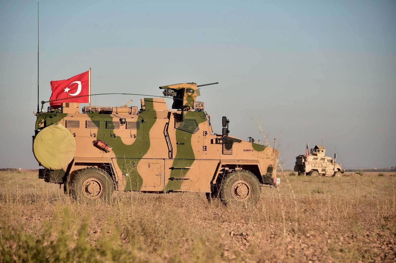 Turkish and U.S. troops conduct joint patrols around the Syrian town of Manbij
