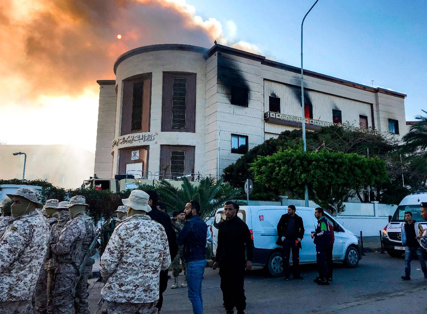 A picture taken on December 25, 2018 shows paramedics and security officers at the scene of an attack outside the Libyan foreign ministry headquarters in the capital Tripoli.