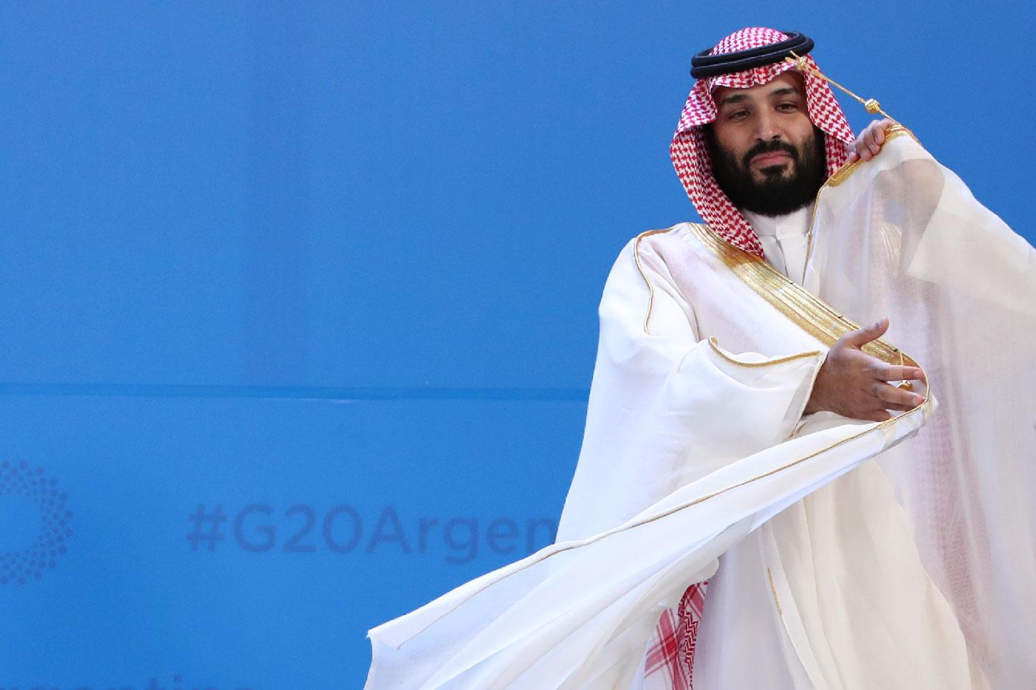 Saudi Arabia's Crown Prince Mohammed bin Salman adjusts his robe as leaders gather for the group at the G20 Leader's Summit at the Costa Salguero Center in Buenos Aires, Argentina, Friday, Nov. 30, 2018.
