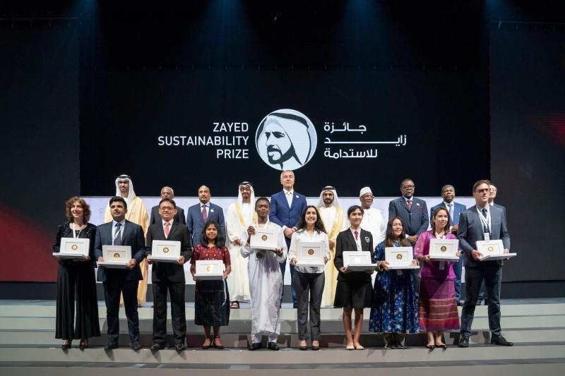 Abu Dhabi Crown Prince Sheikh Mohammed bin Zayed al-Nahyan (2nd row, 4th L) and UAE Vice-President Sheikh Mohamed bin Rashid Al Maktoum (2nd row, 6th L) pose with the winners of the Zayed Sustainability Prize for Energy.