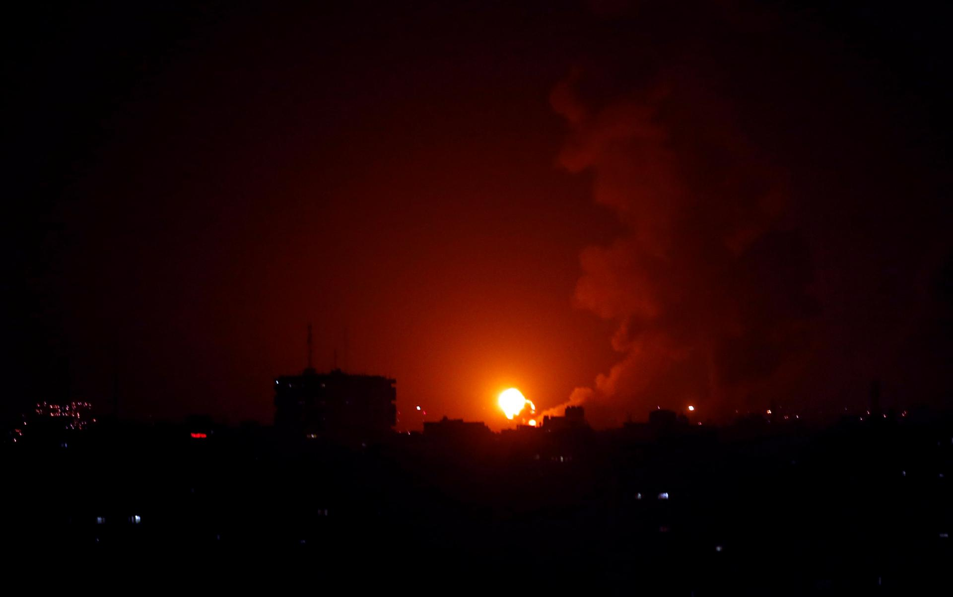 An explosion is seen during Israeli air strikes in Gaza January 22, 2019.