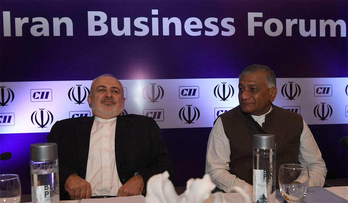 Iranian FM Javad Zarif (L) and Indian Minister of State for External Affairs VK Singh