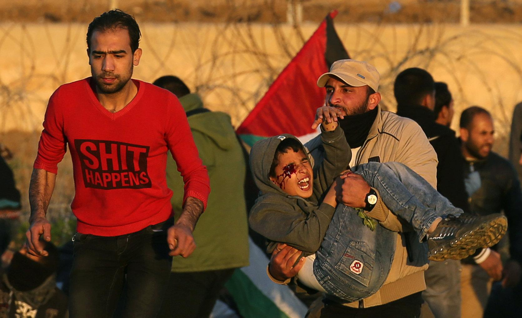 A wounded Palestinian boy is evacuated during a protest at the Israel-Gaza fence, in the southern Gaza Strip January 11, 2019.