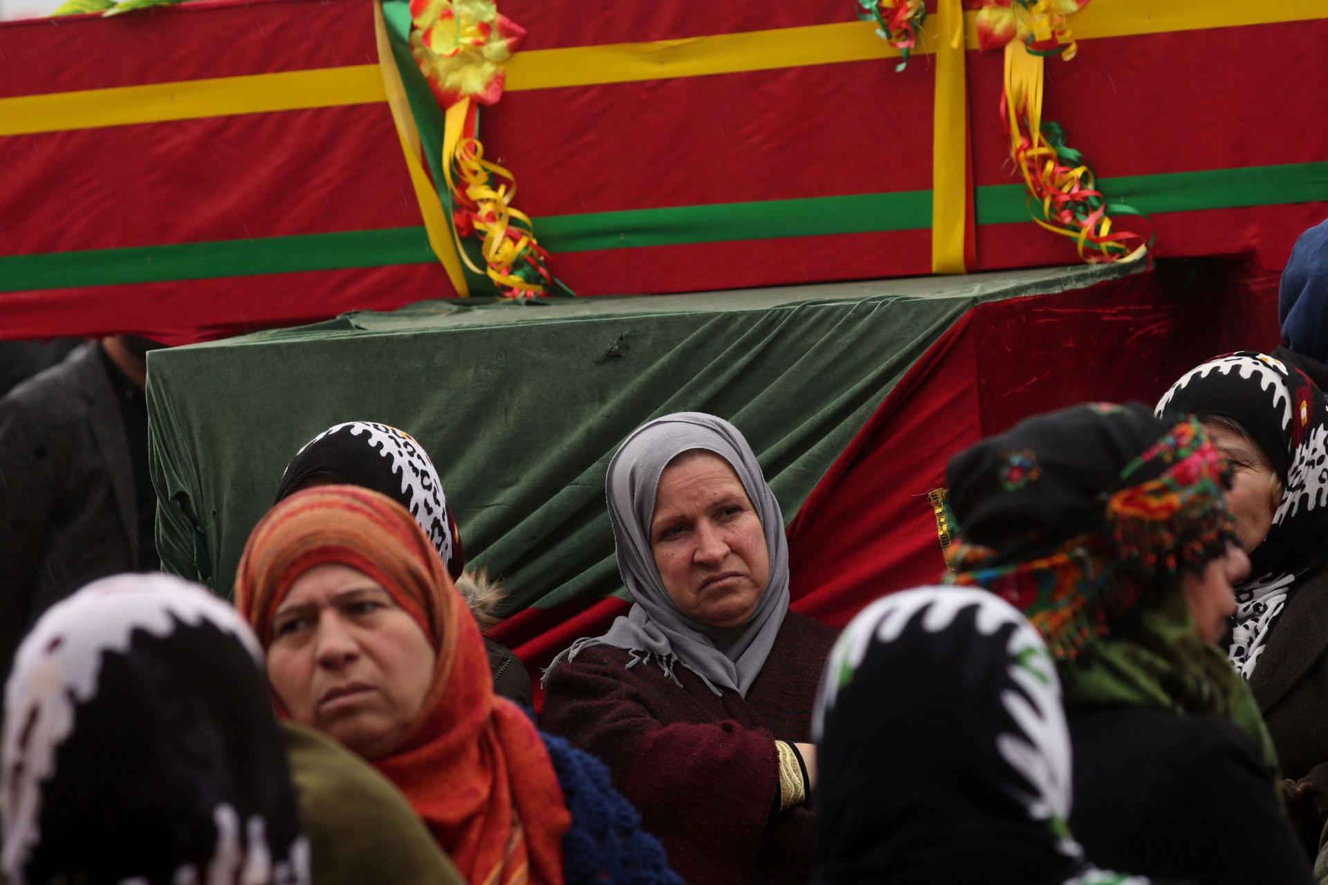 Mourners surround the coffin of a local official, who fighters from the Syrian Democratic Forces (SDF) say was assassinated in a Kurdish-held area in the countryside of Deir Ezzor, during his funeral in northeastern Syrian Kurdish-majority city of Qamishli, on December 31, 2018.