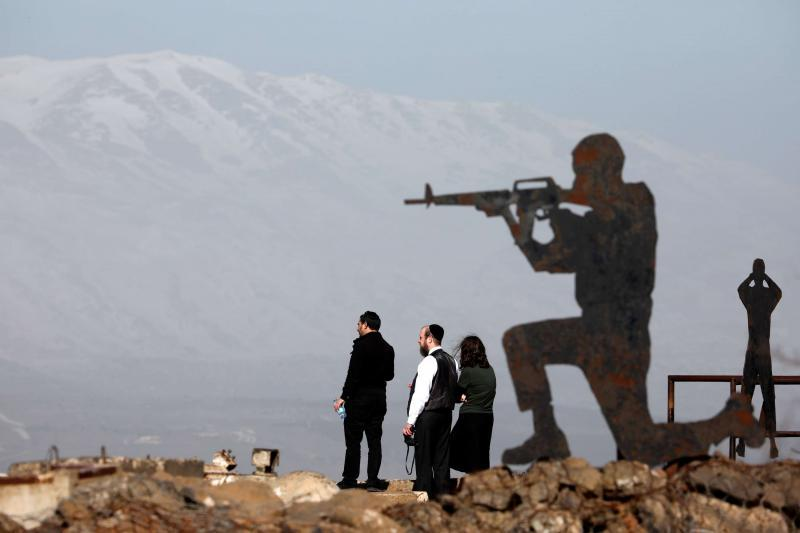 New escalation. People stand next to metal sculptures at Mount Bental, an observation post in the Israeli-occupied Golan Heights.