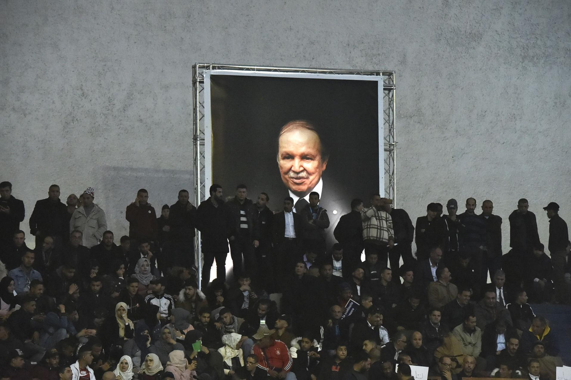 Supporters of Algferia's National Liberation Front (FLN) party, gather at La Coupole arena in the capital Algiers on February 9, 2019, to call upon the current President Abdelaziz Bouteflika (poster) to run for a fifth term in office.