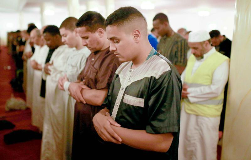 People pray at the Grand Mosque of Saint-Denis near Paris