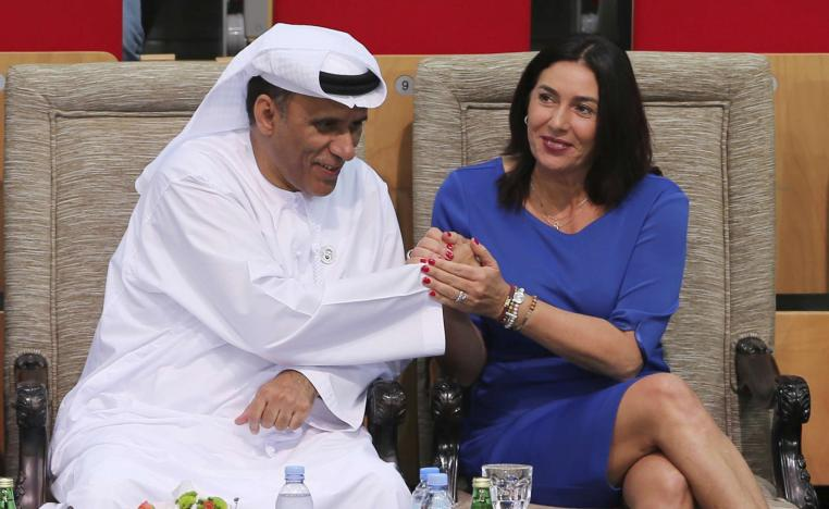 Israeli Culture and Sport Minister Miri Regev, right, shakes hands with Mohamed Bin Tha'loob Al Derai, President of UAE Wrestling Judo & Kickboxing Federation.