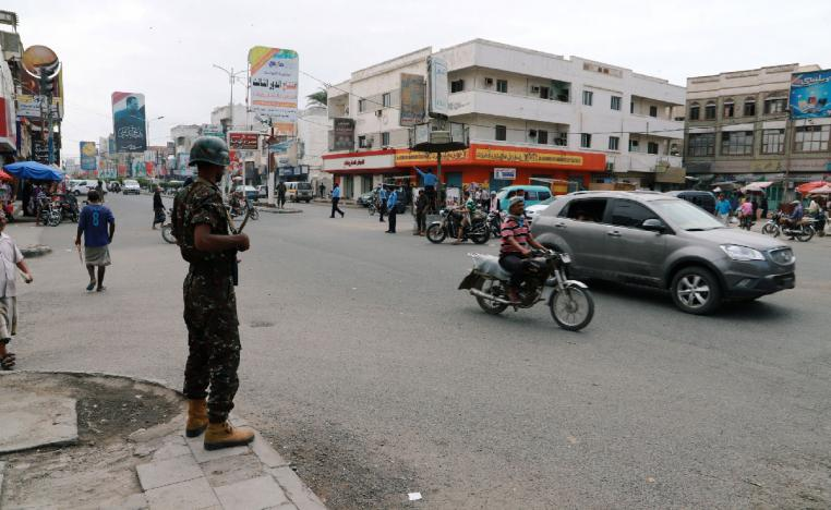 Police trooper stands guard on a street in the Red Sea port city of Hodeidah, Yemen February 13, 2019.