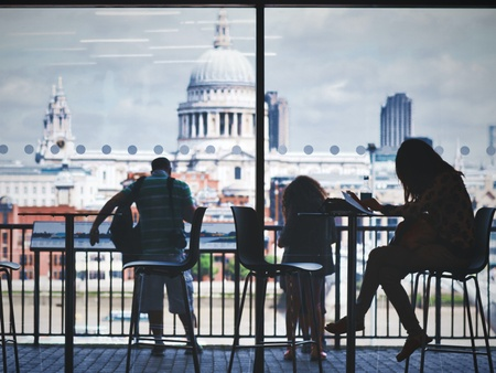 People sitting against the backdrop of St Paul's